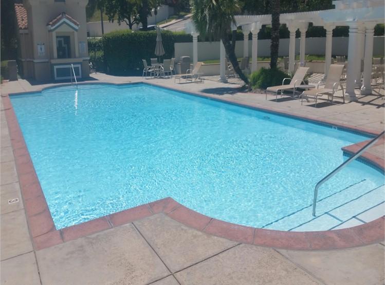 Polished Pools maintaining a community HOA pool.